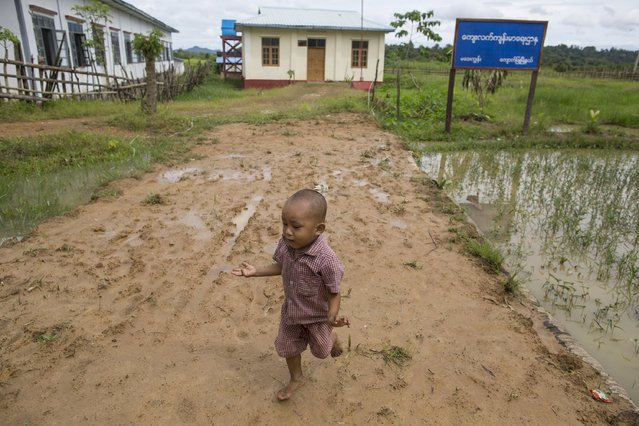 A boy runs barefoot as he plays in front of a clinic which was donated by China's oil pipeline project on Madae island, Kyaukpyu township, Rakhine state, Myanmar October 7, 2015. (Photo by Soe Zeya Tun/Reuters)