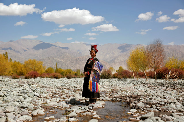 "Tsewang Dolma, 33, a farmer and housewife poses for a photograph in Matho, a village nestled high in the Indian Himalayas, India September 29, 2016. When asked how living in the world's fastest growing major economy had affected life, Dolma replied: ""Our culture is spoiled now. We don't wear our traditional dress"". (Photo by Cathal McNaughton/Reuters)"