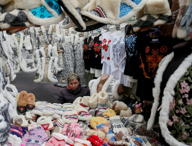 A street vendor selling warm clothes waits for customers in central Lviv, Ukraine, October 20, 2016. Picture taken October 20, 2016. (Photo by Gleb Garanich/Reuters)