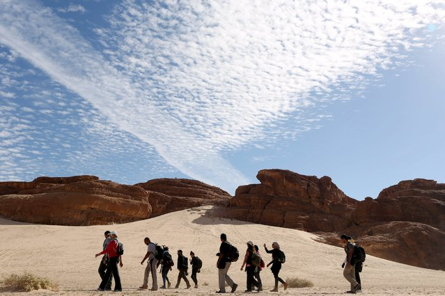 Hikers walk in the Wadi Hudra area in South Sinai, Egypt, November 21, 2015. (Photo by Asmaa Waguih/Reuters)