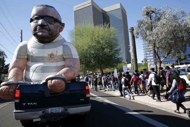 An effigy showing Maricopa County Sherrif Joe Arpaio in handcuffs is paraded in a student protest on election day in downtown Phoenix, Arizona, November 8, 2016. The controversial Arizona sheriff was up for re-election. (Photo by Nancy Wiechec/Reuters)