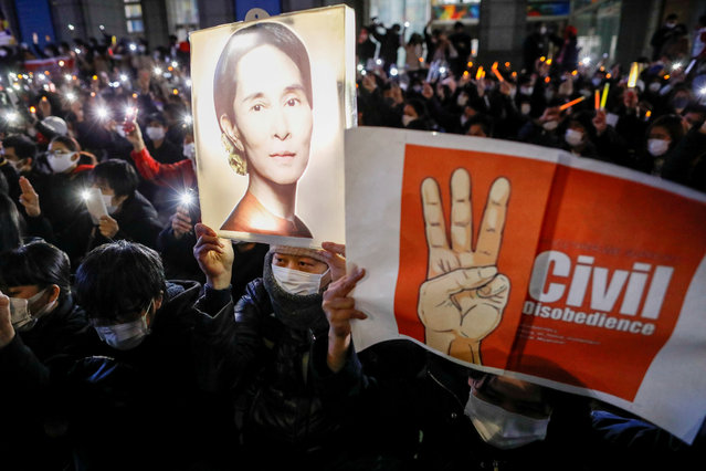 Demonstrators turn on their mobile phone torches as they protest against Myanmar military coup, in Tokyo, Japan, February 11, 2021. (Photo by Issei Kato/Reuters)