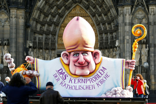 """A carnival float showing an unnamed bishop from the 2021 """"Rosenmontag"""" (Rose Monday) parade of Duesseldorf is placed in front of the Cologne Cathedral by activists of the Giordano Bruno Foundation to protest against sеxual abuse by Catholic priests at the beginning of a three-day virtual meeting of Germany's Bishops' Conference in Cologne, Germany, February 23, 2021. (Photo by Thilo Schmuelgen/Reuters)"""