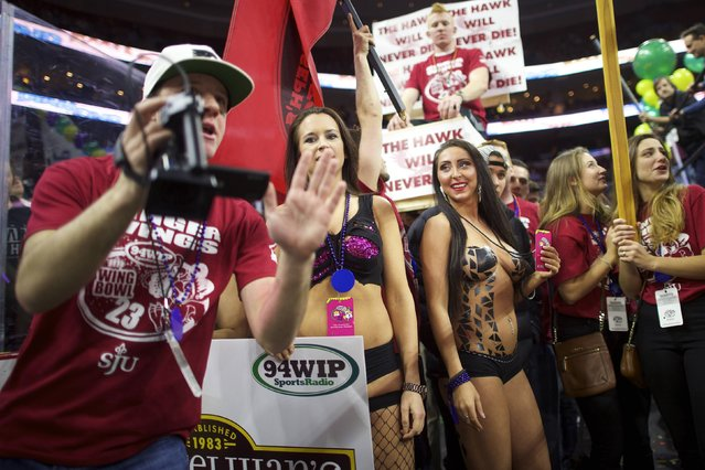 Cheerleaders supporting participants wait for their turn at a parade before the 23rd annual Wing Bowl at the Wells Fargo Center in Philadelphia, Pennsylvania January 30, 2015. (Photo by Mark Makela/Reuters)