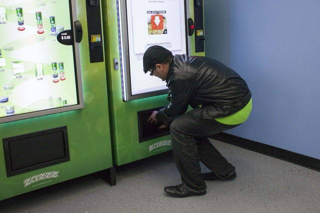 Lynyrd Puyat uses a ZaZZZ vending machine to purchase one gram of the Girl Scout Cookies strain of marijuana for $15 at Seattle Caregivers, a medical marijuana dispensary, in Seattle, Washington February 3, 2015. (Photo by David Ryder/Reuters)