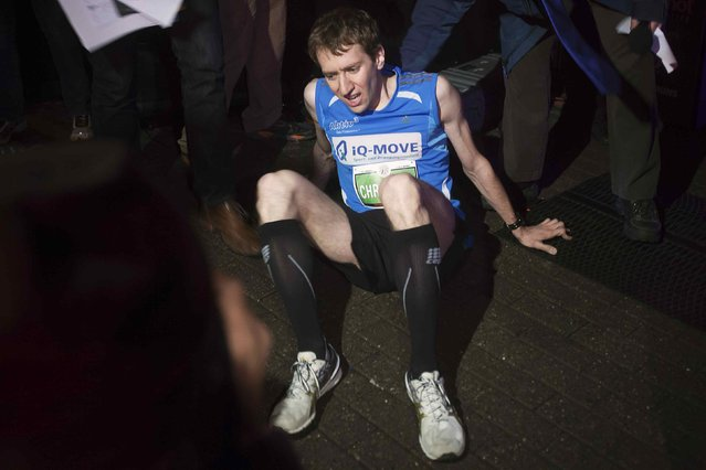 Christian Riedl of Germany sits on the 86th floor after winning the Men's Elite class of the 38th Annual Empire State Building Run-Up in the Manhattan borough of New York February 4, 2015. (Photo by Carlo Allegri/Reuters)