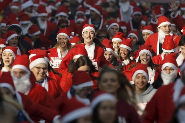 People dressed as Santa Claus run during an annual race in Belgrade, Serbia December 27, 2015. (Photo by Marko Djurica/Reuters)