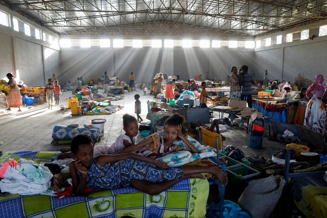 Displaced people are seen at the Shire campus of Aksum University, which was turned into a temporary shelter for people displaced by conflict, in the town of Shire, Tigray region, Ethiopia, March 14, 2021. Families described fleeing from ethnic Amhara militia in the Tigray region, four months after the Ethiopian government declared victory over the rebellious Tigray People's Liberation Front (TPLF). (Photo by Baz Ratner/Reuters)