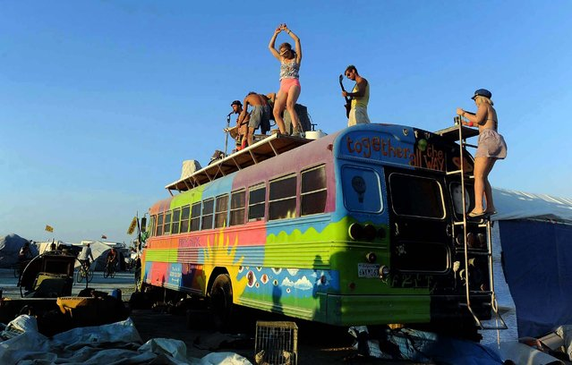 A band plays on top of a bus. (Photo by Andy Barron/The Reno Gazette-Journal)