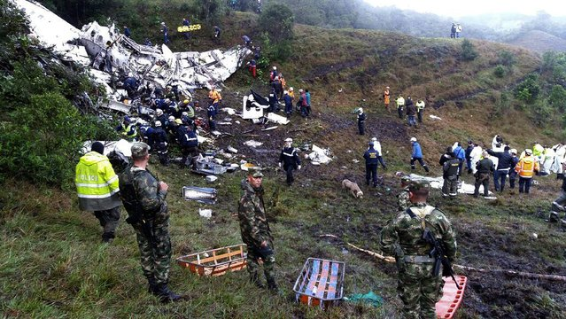 A handout picture provided by the Colombian Air Force shows Rescue teams at the scene of the plane crash in the municipality of La Union, Department of Antioquia, Colombia, 29 November 2016. According to reports, 75 people died when an aircraft crashed late 28 November 2016 with 81 people on board, including players of the Brazilian soccer club Chapecoense. The plane crashed in a mountainous area outside Medellin, Colombia as it was approaching the Jose Maria Cordoba airport. The cause of the incident is as yet uknown. Chapecoense were scheduled to play in the Copa Sudamericana final against Medellin's Atletico Nacional on 30 November 2016. (Photo by EPA/Colombia Air Force)