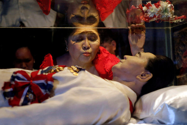 Former first lady Imelda Marcos kisses the glass coffin of her husband, late president Ferdinand Marcos, who remains unburied since his death in 1989, during her 85th birthday celebration in Ferdinand Marcos' hometown of Batac, Ilocos Norte province, in northern Philippines July 2, 2014. (Photo by Erik De Castro/Reuters)