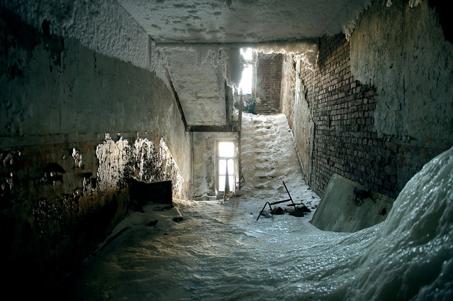 2011. A building in Norilsk sits abandoned after a damaged pipe filled it with water. Despite its prosperity, Norilsk faces a huge maintenance problem. The majority of buildings were constructed on pilings, which are now shifting due to melting permafrost. (Photo by Elena Chernyshova)