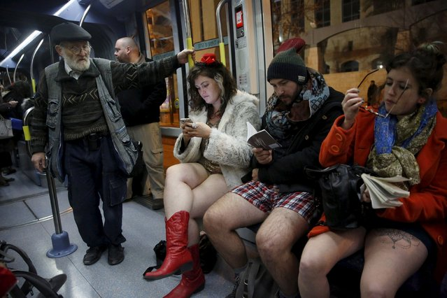 """Israelis travel on a light rail without their pants on as they take part in the third annual """"No pants subway ride"""" event in Jerusalem January 10, 2016. (Photo by Ronen Zvulun/Reuters)"""