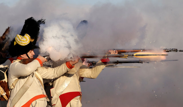 History enthusiasts, dressed as soldiers, fight during the re-enactment of Napoleon's famous battle of Austerlitz near the southern Moravian town of Slavkov u Brna, Czech Republic December 3, 2016. The Battle of Austerlitz, also known as the Battle of the Three Emperors, was one of the most important and decisive engagements of the Napoleonic Wars. In what is widely regarded as the greatest victory achieved by Napoleon, the Grande Armée of France defeated a larger Russian and Austrian army led by Tsar Alexander I and Holy Roman Emperor Francis II. The battle occurred near the village of Austerlitz in the Austrian Empire (modern-day Slavkov u Brna in the Czech Republic). Austerlitz brought the War of the Third Coalition to a rapid end, with the Treaty of Pressburg signed by the Austrians later in the month. (Photo by David W. Cerny/Reuters)
