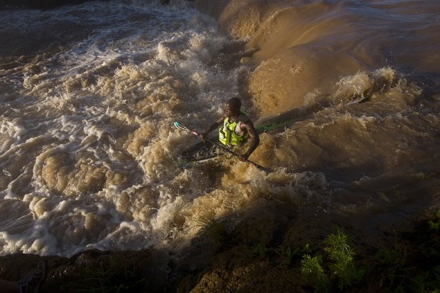 A canoeist negotiates a rapid during the Dusi Canoe Marathon in Pietermaritzburg, South Africa February 19, 2015. The 120-kilometre event is held over three days from Pietermaritzburg to Durban. (Photo by Rogan Ward/Reuters)
