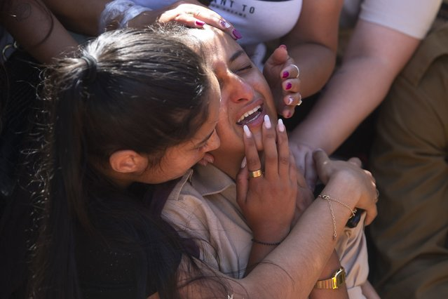 Friends and relatives of Israeli soldier Omer Tabib, 21, mourn during his funeral at the cemetery in the northern Israeli town of Elyakim, Thursday, May 13, 2021. The Israeli army confirmed that Tabib was killed in an anti-tank missile attack near the Gaza Strip, the first Israeli military death in the current fighting between Israelis and Palestinians. (Photo by Sebastian Scheiner/AP Photo)