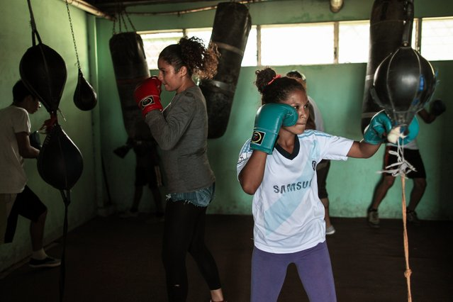 Women train with punch bags at the National Institute of Sport in Managua March 4, 2015. (Photo by Oswaldo Rivas/Reuters)