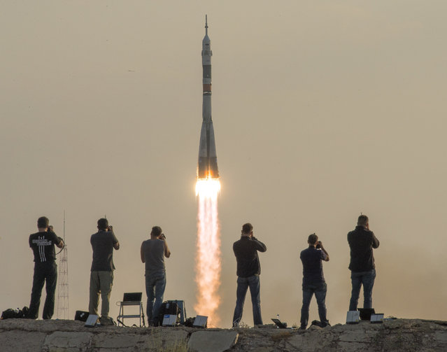 In this handout provided by NASA, the Soyuz MS-01 spacecraft launches from the Baikonur Cosmodrome with Expedition 48-49 crewmembers Kate Rubins of NASA, Anatoly Ivanishin of Roscosmos and Takuya Onishi of the Japan Aerospace Exploration Agency (JAXA) onboard, Thursday, July 7, 2016 , Kazakh time (July 6 Eastern time), Baikonur, Kazakhstan. Rubins, Ivanishin, and Onishi will spend approximately four months on the orbital complex, returning to Earth in October. (Photo by Bill Ingalls/NASA via Getty Images)