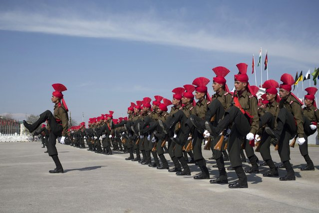 Newly raised soldiers of the Indian Army's Jammu Kashmir Light Infantry Regiment (JKLIR) march during their commencement parade at a military base on the outskirts of Srinagar, India, Friday, March 27, 2015. 183 recruits from Jammu and Kashmir state were formally inducted into JKLIR after completing their training. (Photo by Dar Yasin/AP Photo)