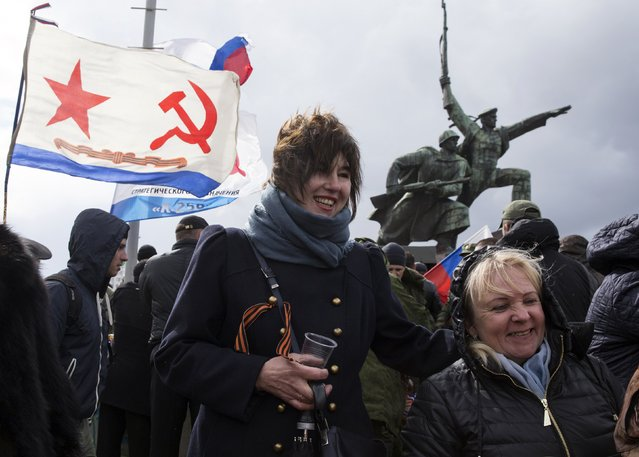 People take part in celebrations for the first anniversary of the Crimean treaty signing in Sevastopol, March 18, 2015. (Photo by Maxim Shemetov/Reuters)
