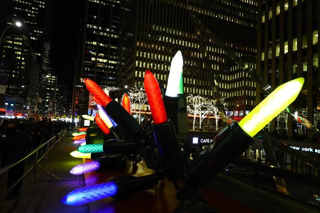 Giant Christmas lights line the sidewalk near Radio City Music Hall in New York City on December 19, 2018. (Photo by Gordon Donovan/Yahoo News)