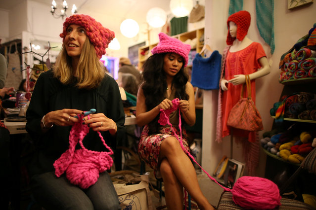 Jayna Zweiman and Krista Suh take part in the Pussyhat social media campaign they created to provide pink hats for protesters in the women's march in Washington, D.C., the day after the presidential inauguration, in Los Angeles, California, U.S., January 13, 2017. (Photo by Lucy Nicholson/Reuters)