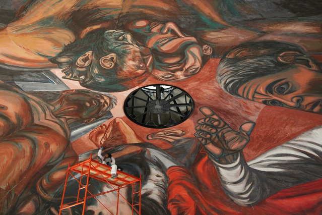 "Expert restorers and technicians of the National Institute of Fine Arts (INBA) and the School of Conservation and Restoration of the West during the restoration works of the mural ""The creative and rebellious man"" by Jose Clemente Orozco, who suffered damage during the earthquake on 11 May 2015 in Guadalajara, western Mexico, 16 January 2017. The quake of magnitude 4.8 on the Richter scale caused cracks, fissures and paint peeling in at least 20 per cent of the mural created by Orozco in 1937 at the dome of the Auditorium of the University of Guadalajara. (Photo by Ulises Ruiz Basurto/EPA)"