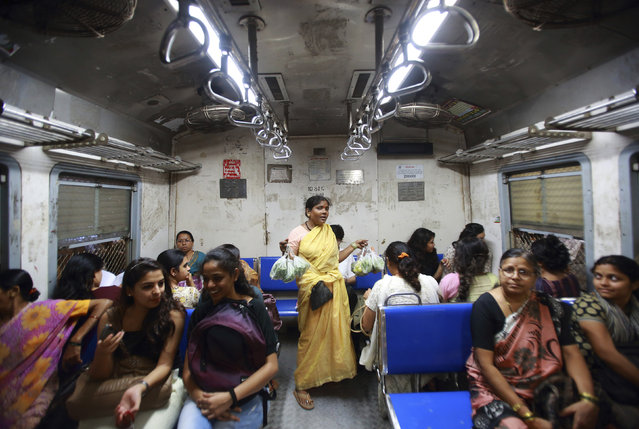 A vendor sells vegetables inside the Ladies' Special train in Mumbai, December 6, 2012. (Photo by Navesh Chitrakar/Reuters)