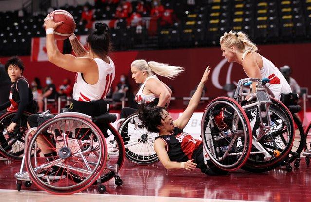 Japan's Chihiro Kitada of Japan falls during their women's wheelchair basketball match against Canada at Ariake Arena in Tokyo, Japan on September 3, 2021. (Photo by Ivan Alvarado/Reuters)