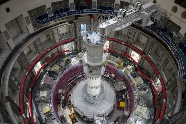 The ITER Tokamak machine is pictured in Saint-Paul-Lez-Durance, France, Thursday, September 9, 2021. Scientists at the International Thermonuclear Experimental Reactor in southern France took delivery of the first part of a massive magnet so strong its American manufacturer claims it can lift an aircraft carrier. (Photo by Daniel Cole/AP Photo)
