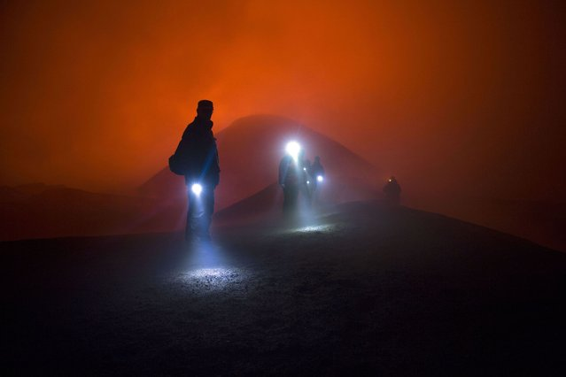 The team on route to the crater of the Plosky Tolbachik volcano. (Photo by Denis Budkov/Caters News)