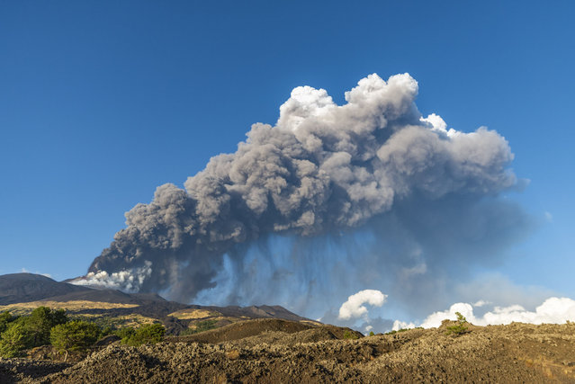 A new eruption at Etna volcano on August 29, 2021 after 20 days from the last event in Catania, Italy. Once again, the Southeast Crater erupted, the highest jets of the lava fountain have reached 600 meters, the eruptive column was carried by the wind to the southeast, and the heavy rain of ash fell on the town of Zafferana Etnea and on neighboring villages. This is the fifty-second eruptive episode in 2021, such a large series of eruptions in such a short period of time had not happened for 20 years. (Photo by Salvatore Allegra/Anadolu Agency via Getty Images)