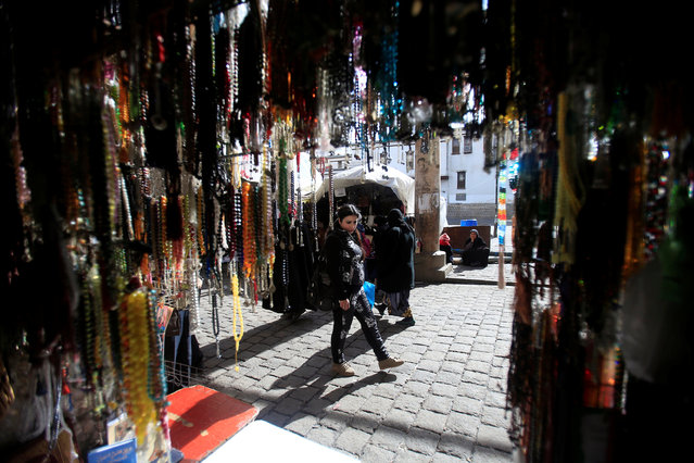 A woman walks along a stall with prayer beads displayed for sale in Damascus, Syria January 27, 2017. (Photo by Ali Hashisho/Reuters)
