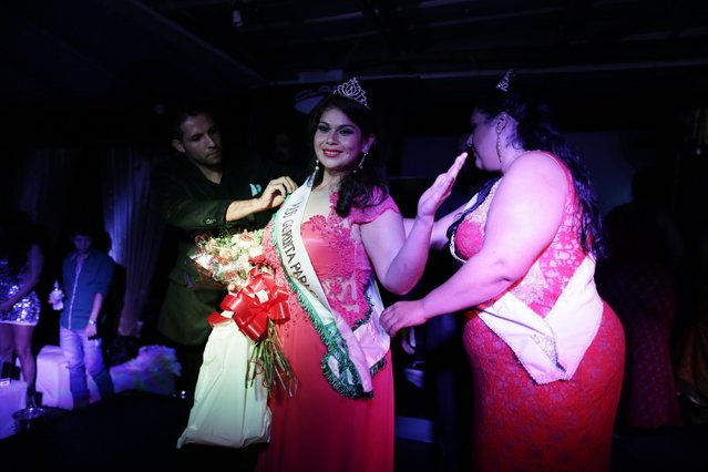 "Raquel Gimenez receives the queen's sash after she was crowned ""Miss Gordita"" from a field of 13 contestants, in Asuncion, Paraguay, Saturday, April 25, 2015. In a country in which 57% of the population is obese according to the Ministry of Health, it's not the most popular of events, attended mostly by friends and family. (Photo by Jorge Saenz/AP Photo)"