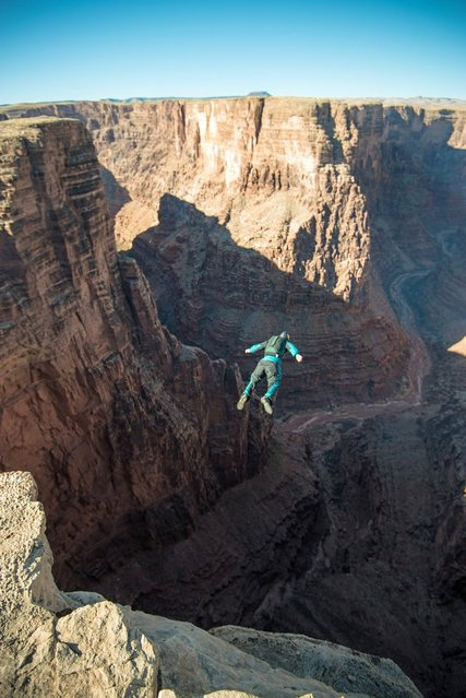 A group of daredevils tackle a series of spectacular sunrise BASE jumps – all before heading home for breakfast. (Photo by Caters News)