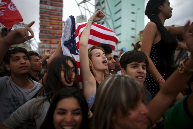 People react during a performance by U.S. electronic music group Major Lazer in Havana, March 6, 2016. (Photo by Alexandre Meneghini/Reuters)