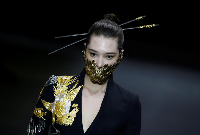 A model presents a creation by designer Xiong Ying at China Fashion Week in Beijing, China March 31, 2019. (Photo by Jason Lee/Reuters)