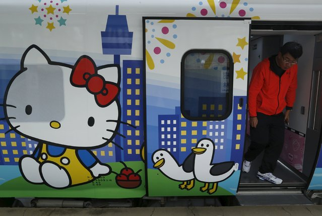 A man walks out from a Hello Kitty-themed Taroko Express train in Taipei, Taiwan March 21, 2016. (Photo by Tyrone Siu/Reuters)
