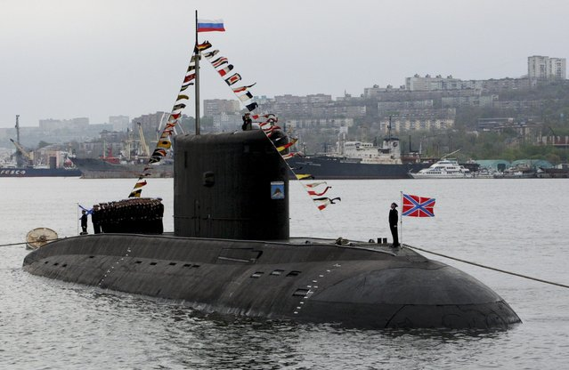 The crew of the Varshavyanka class diesel submarine take part at the Victory Day parade in Vladivostok, Russia, May 9, 2015. (Photo by Reuters/Host Photo Agency/RIA Novosti)