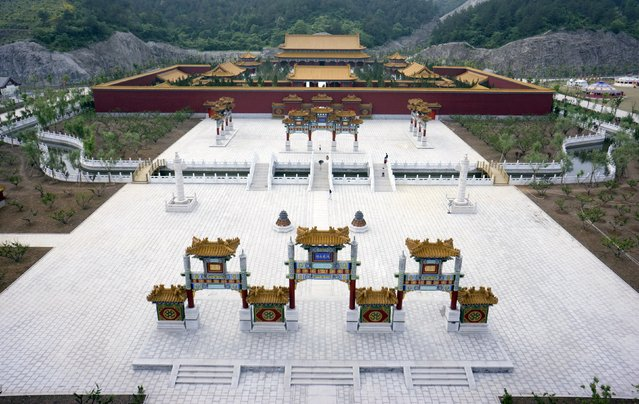 A view shows tourists visiting a newly-built full-scale replica of the Old Summer Palace, also known as Yuanmingyuan, in Dongyang, Zhejiang province, China, May 9, 2015. The replica, partially opened to tourists on Sunday, is aiming to reconstruct 95 percent of the original architecture of the Old Summer Palace in Beijing, which was destroyed in 1860 by British and French troops. (Photo by Reuters/Stringer)