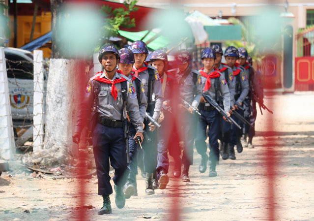 Armed policemen march to the entrance of Myitkyina Prison, Myitkyina of Kachin State, northern Myanmar, 09 May 2019. Inmates from six prisons across Myanmar are protesting for non-inclusion of country's recent presidential amnesties. At least four inmates died as riots occurred in two prisons at Sagaing Region and Kayin State. (Photo by Ah Je/EPA/EFE)