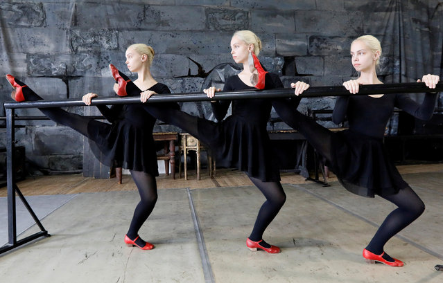 Triplet sisters Natalia, Irina and Tatiana Mironenko attend a rehearsal while preparing for examination performances staged by the graduates of the folk dance faculty of the Krasnoyarsk choreographic college in Krasnoyarsk, Russia May 13, 2019. All three 19-year-old sisters are expected to join the renowned Krasnoyarsk state academic dance ensemble of Siberia after the graduation. (Photo by Ilya Naymushin/Reuters)