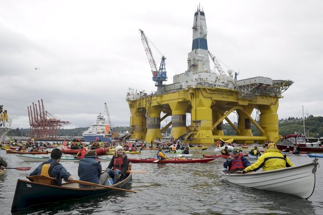 Activists protest the Shell Oil Company's drilling rig Polar Pioneer which is parked at Terminal 5 at the Port of Seattle, Washington May 16, 2015. (Photo by Jason Redmond/Reuters)