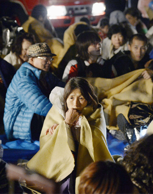 Residents take shelter outside the town hall of Mashiki, near Kumamoto city, southern Japan, after the earthquake early Friday, April 15, 2016. (Photo by Ryosuke Uematsu/Kyodo News via AP Photo)