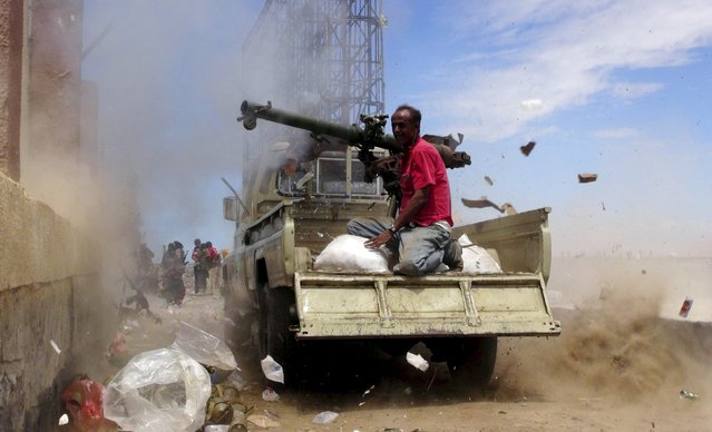 A Southern Popular Resistance fighter fires a weapon mounted on a truck during clashes with Houthi fighters in Yemen's southern city of Aden May 3, 2015. (Photo by Reuters/Stringer)