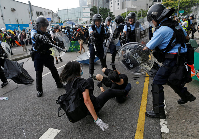 Riot police try to disperse protesters near a flag raising ceremony for the anniversary of Hong Kong handover to China in Hong Kong, China on July 1, 2019. (Photo by Thomas Peter/Reuters)