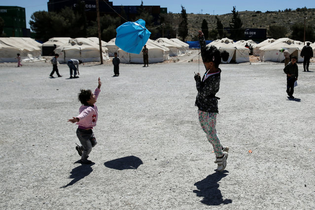 Children play with a plastic bag at a camp for refugees and migrants in Schisto, near Athens, Greece, April 26, 2016. (Photo by Alkis Konstantinidis/Reuters)