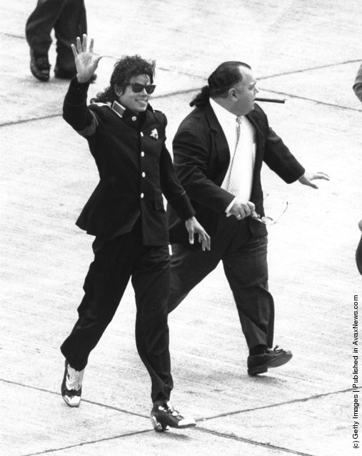 American singer Michael Jackson (1958 - 2009) arrives at Heathrow Airport with his manager Frank DiLeo, on his Bad World Tour, 11th July 1988