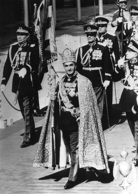 1967: Muhammed Reza Shah Pahlavi (1919 - 1980), the Shah of Iran wearing the Pahlavi crown in procession through Golestan Palace after his coronation in Teheran