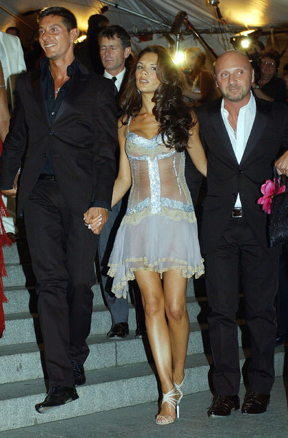 """Former Spice Girl Victoria Beckham (C) poses with designers Stefano Gabbana (L) and Domenico Dolce during """"Goddess: Costume Institute Benefit Gala"""" at the Metropolitan Museum of Art Costume April 28, 2003 in New York City. (Photo by Mark Mainz/Getty Images)"""